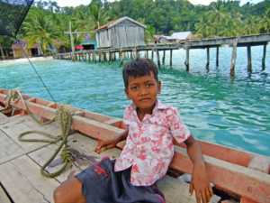 Local Child on at a pier on Koh Rong