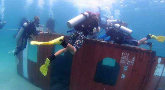 Divers-plats-korall-on-a-shipping-container-off-Koh-Rong-Samloem