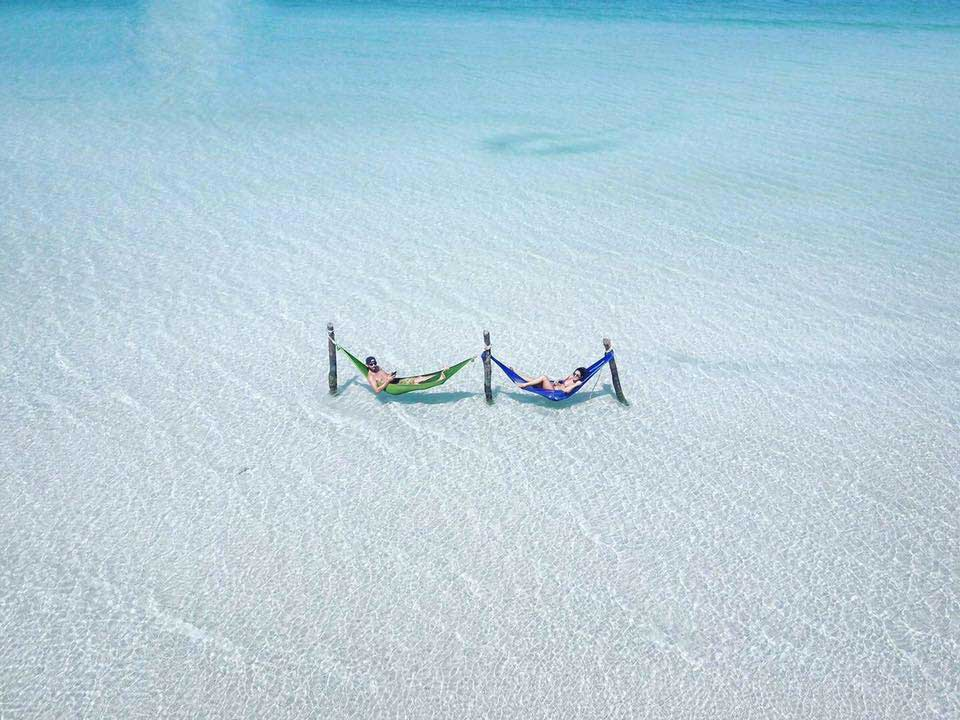 2 People Lying in Hammocks Over Water at Saracen Bay on Koh Rong Samloem